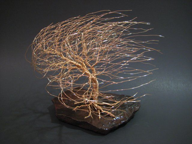 Unique and one of a kind wire tree sculptures made from tarnish-resistant jewelry wire. Willows, windswept, bonsai, oak, and many other wire trees made from wrapping, twisting, and shaping fine wire into an exquisite piece of art.