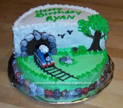Homemade Thomas The Train Cake 103: This Thomas the Train cake was made for my nephew's 2nd birthday.  I used 2 nine inch round cakes cutting one in half and stacking.    The tunnel was made