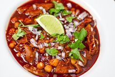 Learn how to make Mexican menudo. This recipe for menudo Mexicano makes a peppery soup filled with tripe, posole, and pig trotters.