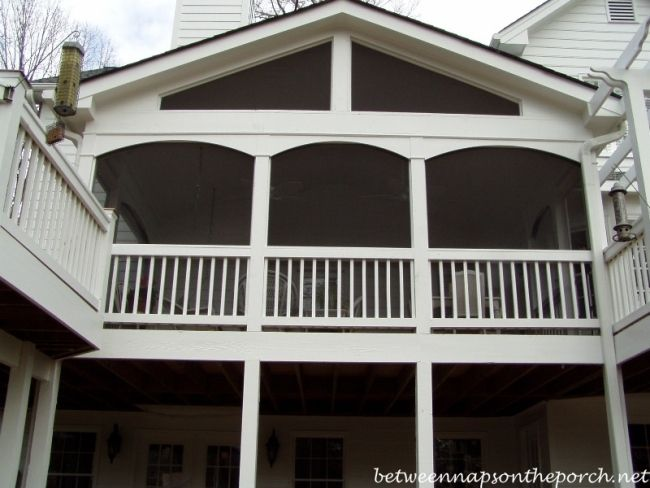 Screened in Porch with arched openings. BetweenNapsOnThePorch.com #porch