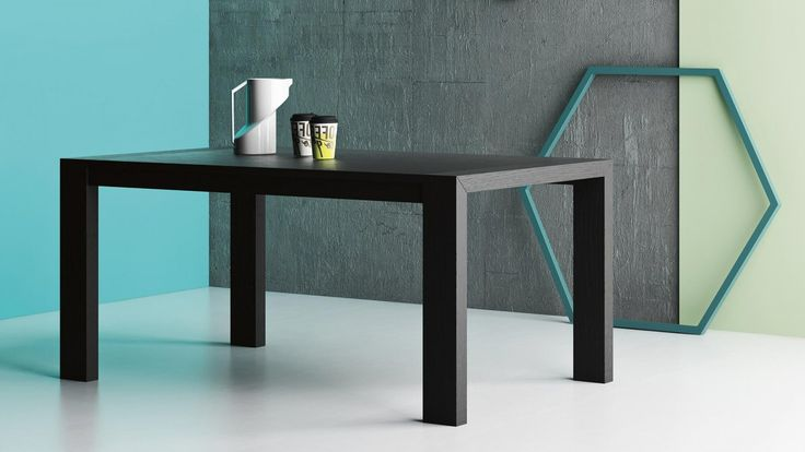 Perla is a table with a linear toughened glass top and streamlined corner legs with a 45° joint. It comes in oak and glass, walnut and glass or entirely in wood with a choice of finishes. Solid wood is used for all versions. The top can also be supplied to customers' measurements.