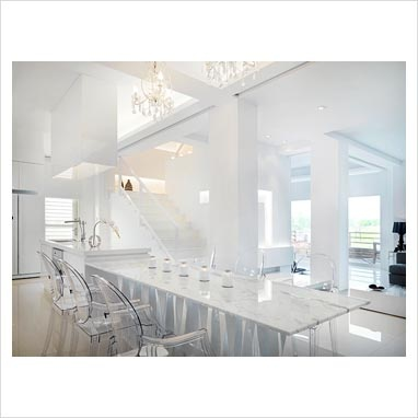 all white. marble dining table and transparent chairs