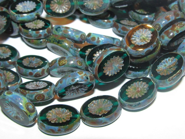 15 - 14X10mm Emerald Green Czech Glass Carved Ovals. Starting at $1 on Tophatter.com!
