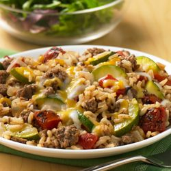 Zucchini Rice and beef! 1 pound ground round beef (85% lean) 2 cups quartered lengthwise, sliced zucchini (2 cups = 1-1/2 med) 1/2 cup chopped onion 1/2 teaspoon salt 1 can (14.5 oz each) Hunt's® Fire Roasted Diced Tomatoes with Garlic, undrained 1 cup water 1-1/2 cups instant white rice, uncooked 3/4 cup shredded Cheddar and Monterey Jack cheese blend