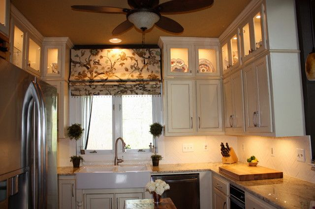 Traditional roman blinds; counter top; white cabinetry; white farmhouse sink; under-cabinet lighting