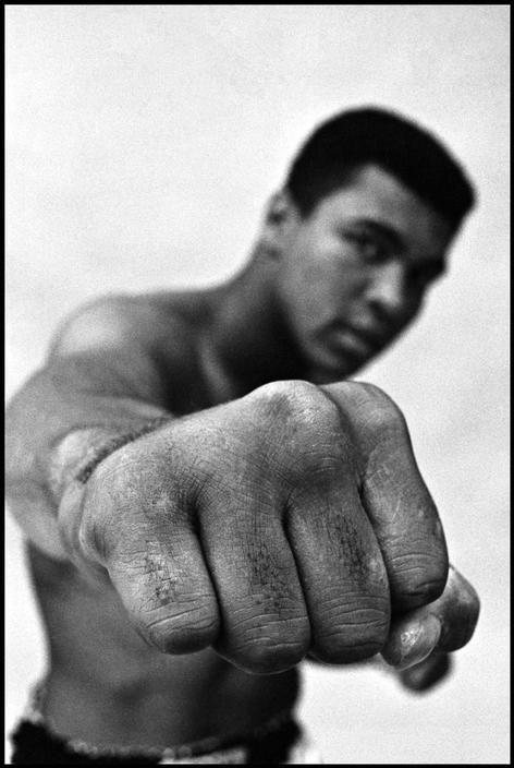 Muhammad ALI, boxing world heavy weight champion showing off his right fist. 1966.