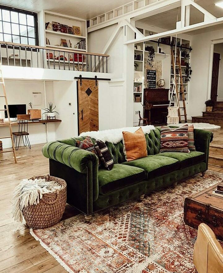 A Vintage Industrial Barn Home With A Beautiful Green Velvet Sofa