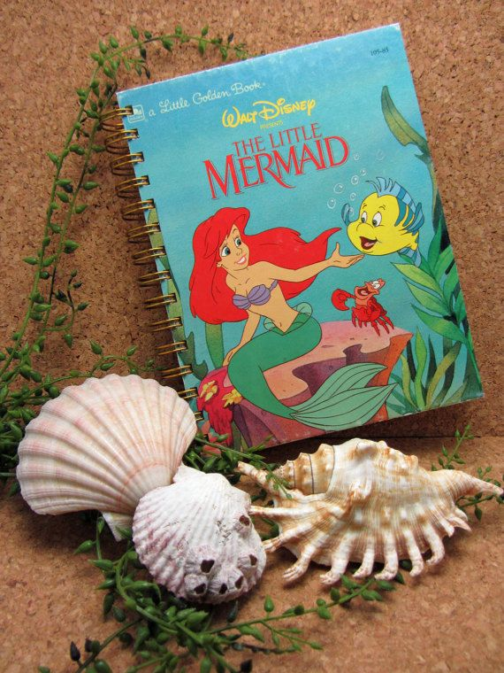 Disney's The Little Mermaid Little Golden Book re-purposed into a unique wire-bound journal/sketchbook/Disney World Autograph Book with the original hardcover. The original story pages are also included, along with approximately 130 sheets of new, blank, unlined white paper cut to fit.  Disney's The Little Mermaid Little Golden Book  Measures Approximately 8 inches by 6 inches  Note: All of my journals are constructed from pre-loved books, so please expect the original cover and pag...