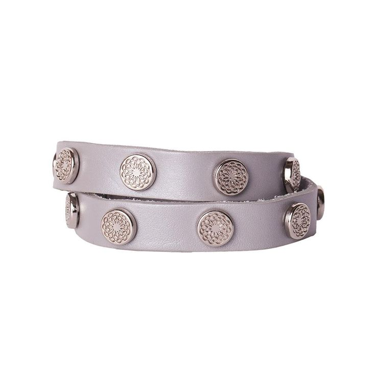 With its shimmering silvery surface and silver-toned floral studs, this unique leather wrap makes a compelling statement of style and personality.  Product Material - Genuine leather with Zinc Alloy studs