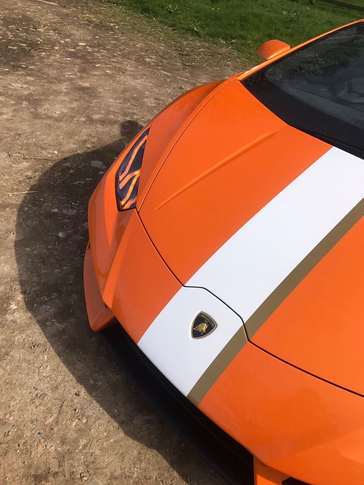 Lamborghini Huracan LP580-2 Coupe painted in Arancio Borealis w/ a center stripe inspired by the Lamborghini Gallardo Balboni Edition Photo taken by: @wallacepjw on Instagram