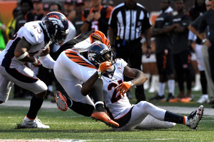 Cornerback Aqib Talib #21 of the Denver Broncos makes a tackle wide receiver Brandon LaFell #11 of the Cincinnati Bengals at Paul Brown stadium Cincinnati, OH September 25, 2016. Joe Amon, The Denver Post