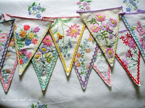 cute flags banner made from vintage embroidered table cloths or pillow cases
