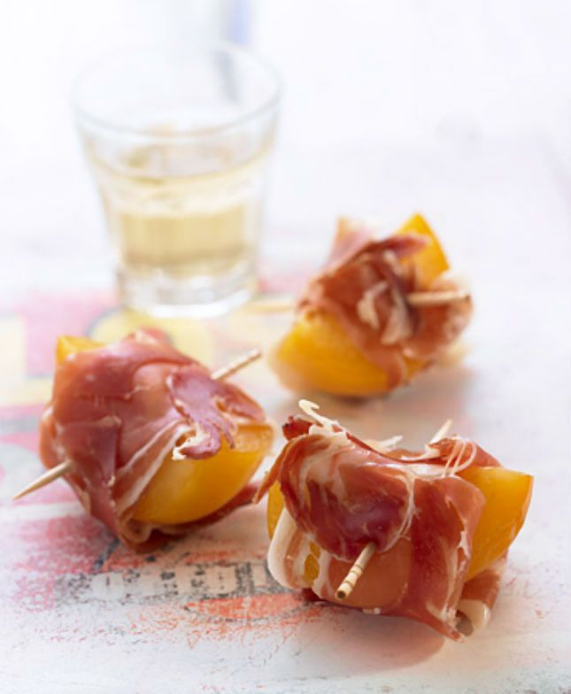 Wrap plums in Serrano ham to make this appetizer.
