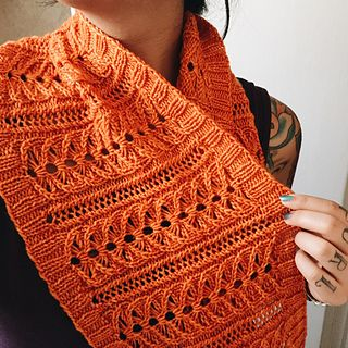 Lily, a sweet lace cowl worked in the round from the bottom up. It's long enough to wrap around the neck twice and can be made wider or shorter simply by adding or removing repeats.
