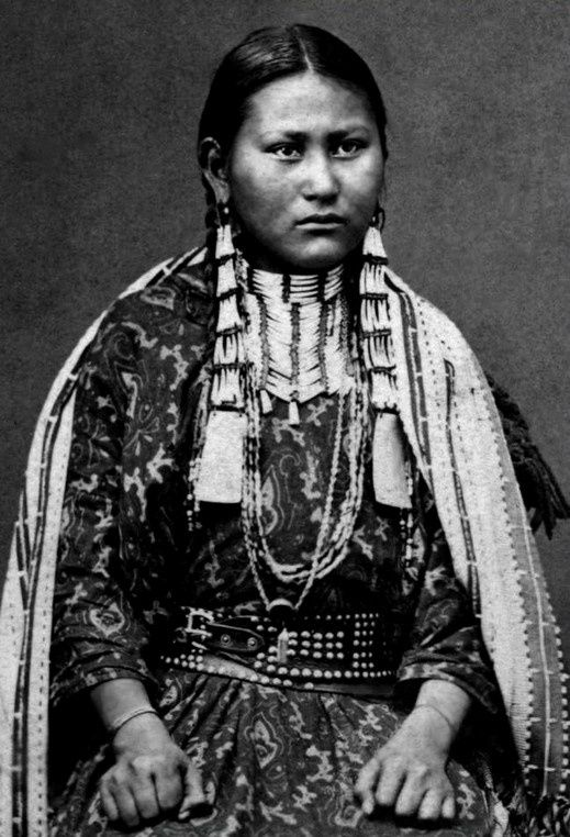 The illustration documents a Dakota Sioux woman carrying ...
