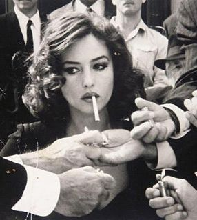 Monica Bellucci with a cigarette - I'm not into smoking but I love this shot - the power of a sexy woman!!!