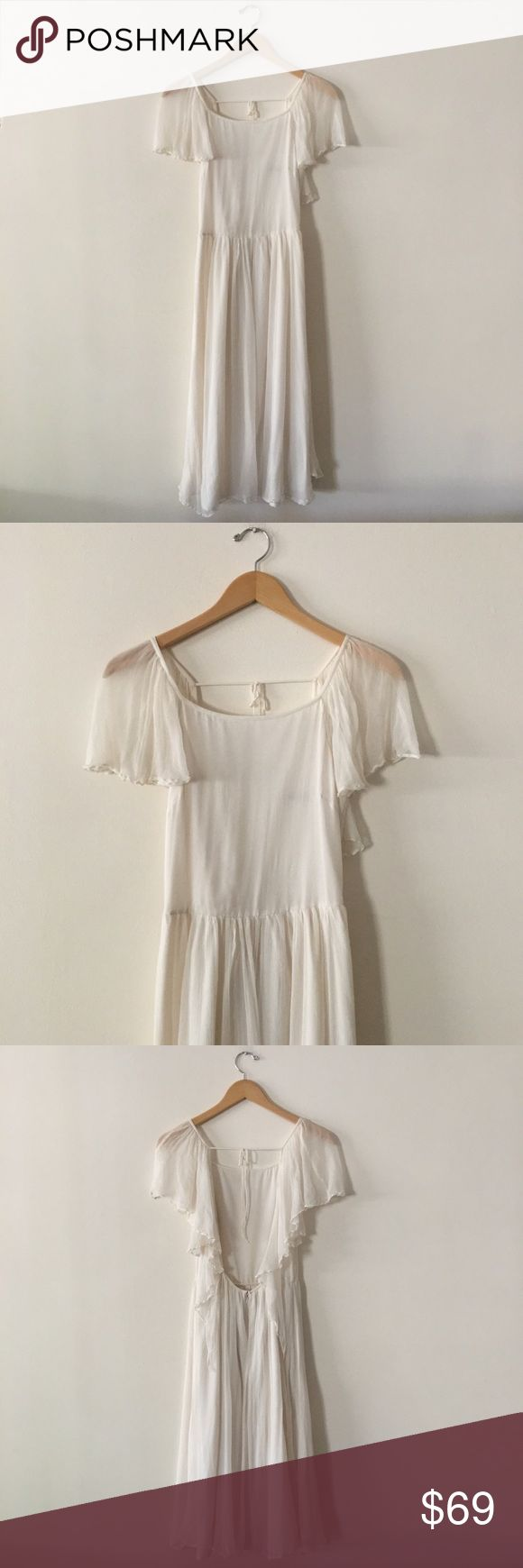 """Topshop Flowy Cascade Maxi Dress Cream colored dress with gorgeous back design. Back of dress features a tie across upper back and flowy chiffon angel wings. Back zipper with clasp. *Front has a small light stain near waist. See photo for reference. Length: 44"""" Armpit to Armpit: 16"""" Topshop Dresses Maxi"""