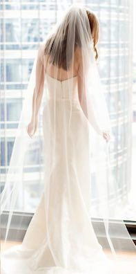 Sleek strapless gown with long sheer bridal veil and floor length skirt | wedding dress | chicago makeup artist