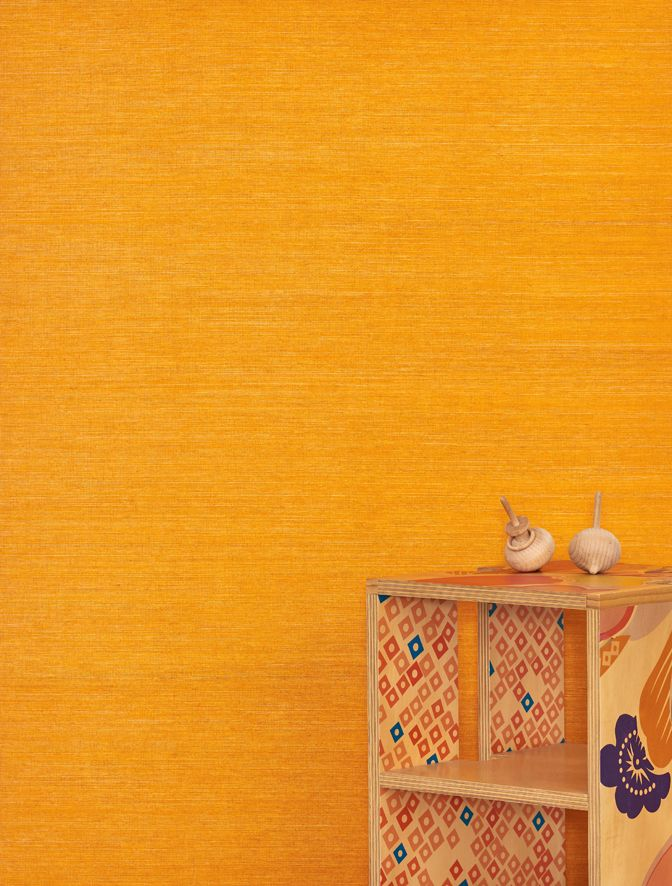 Our vibrant natural grassweave wallcovering Sri Lanka features here in Papaya with Workshopped's table and Cult's spinning tops.