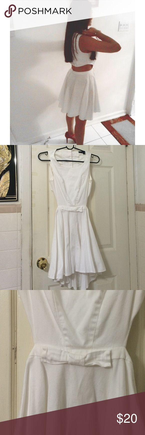 Guess dress Beautiful white open back guess dress. Two balls of two buttons are missing. Other than that it is in good condition. Guess Dresses