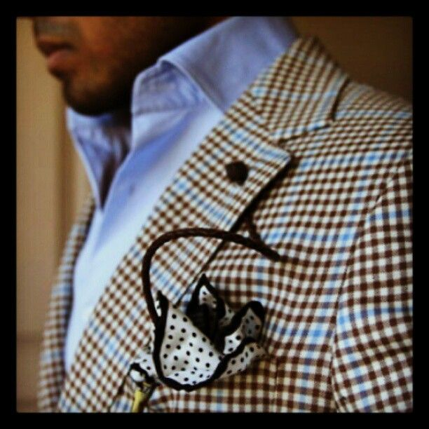 Note how the color of the windowpane doesn't exactly match the shirt. This is a good thing. And don't worry about mixing the jacket pattern with that of the pocket square; pocket squares were invented to buck the rules.