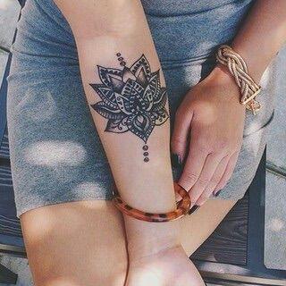 Image via We Heart It #arm #flower #skirt #tattoo