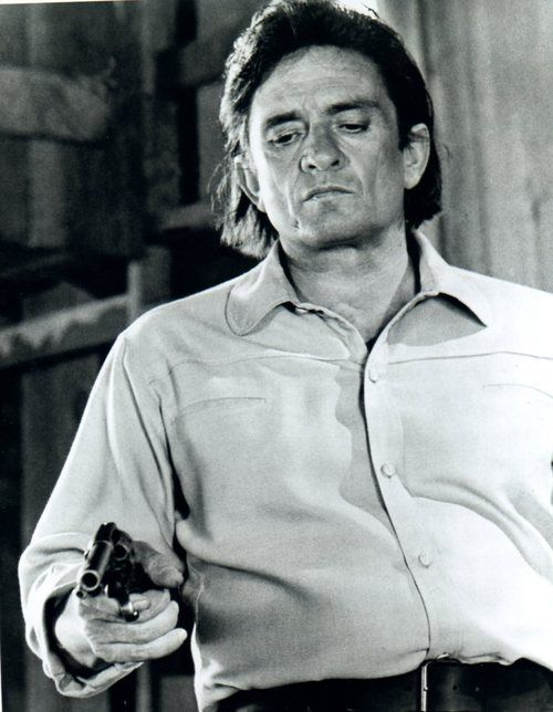 """"""" I saw a lone rider crossing the plane,I drew a bead on him to practice my aim,my brothers rifle went off in my hand a shot rang out across the land,the horse he kept running the rider was dead,I hung my head""""                            ~Johnny Cash"""