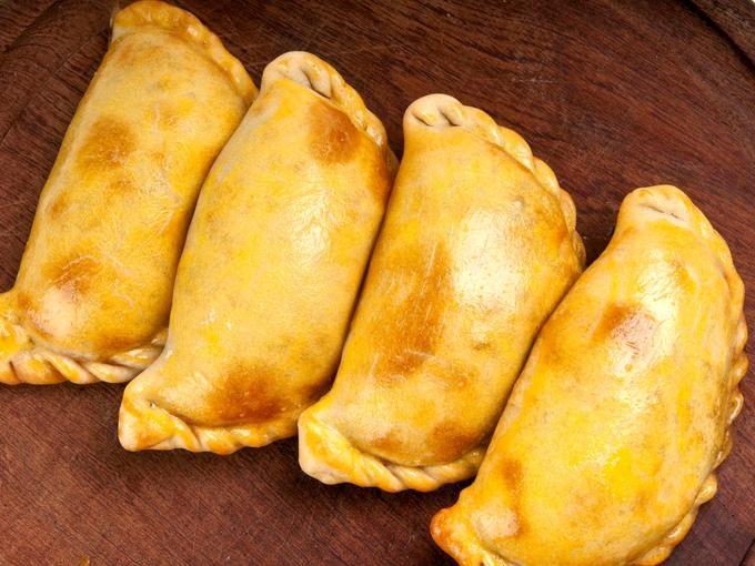 Chile -- Empanadas: The empanada is the national food of Chile, although it is cooked and served throughout Latin America. They are often filled with beef, fish, or beans and cheese, although there are a variety of preparations.