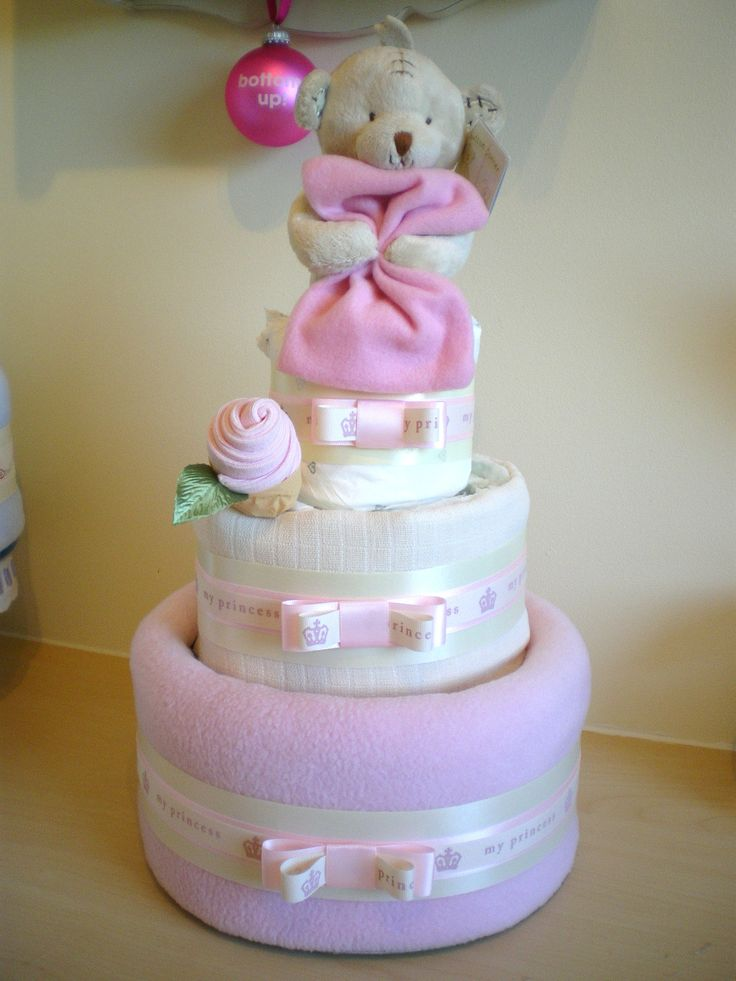 Pink 3 tier nappy cake with Button Corner Bear plush topper and sock rosebud.