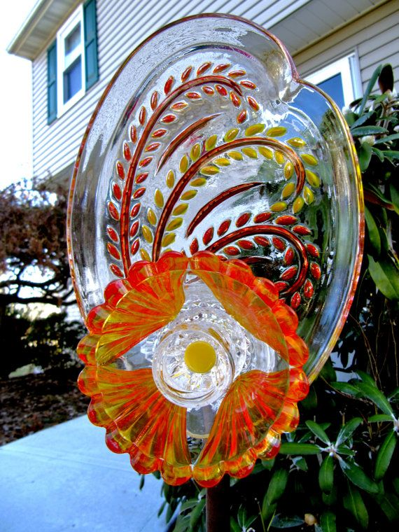 25 best ideas about recycled yard art on pinterest for Recycled glass projects