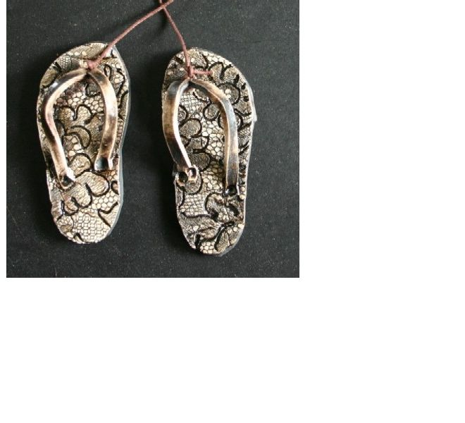 Smalll ceramic jandals with a lace design. Ceramic wall hanging by New Zealand artist Gifted Earth NZ.