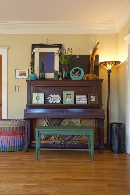For those who've got a family heirloom piano that needs a smoother transition into their decor. Cool it up with some plant life, objects and photos in funky frames!