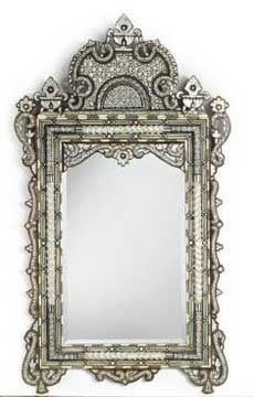 Moroccan furnishings have elaborate wrought iron scroll work, mother of pearl inlay, ornately carved wood in high relief,