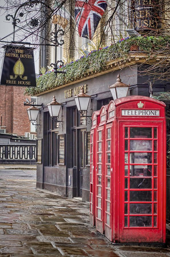 """The Local"" --- Red telephone boxes outside a pub in Greenwich, London on a rainy day."