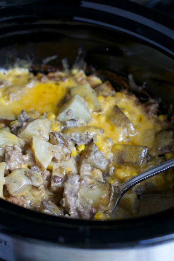 I've got a fun recipe for you today. This Slow Cooker Hamburger Hash recipe turns out wonderful! Tender Potatoes, sauce, meat, corn and cheese.