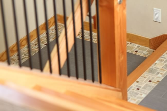 Stair Detail- Porcelain floor with Mosaic Insert and Wood nosing