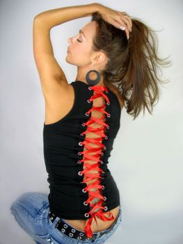 Corset with grommets made from a T.  I just bought a grommet gun - I am going to try and make this!