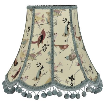 Handmade lampshade in a traditional scalloped shape. Made in birds fabric with duck egg blue trim and pom poms. Bespoke lampshades available