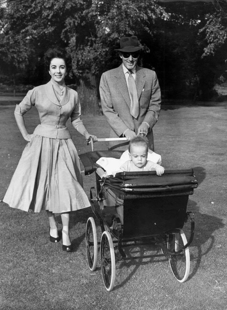 Elizabeth Taylor, Michael Wilding, Michael Junior.  Look at that carriage!