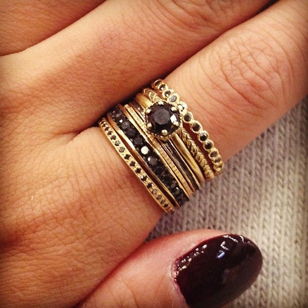 stacked rings + dark manicure.