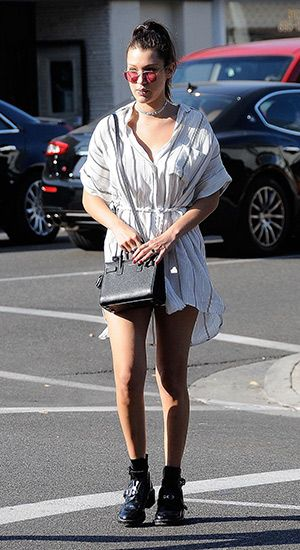 #bellahadid out and about spending time with her dad Mohammed Hadid (not pictured) in Los Angeles, CA on August 20, 2015. Bella´s wearing a  Faithfull The Brand Castaway Dress http://api.shopstyle.com/action/apiVisitRetailer?id=486223543&pid=uid7729-3100527-84,  Ray-Ban sunglasses, a  Saint Laurent mini 'Sac Du Jour' tote http://api.shopstyle.com/action/apiVisitRetailer?id=482958335&pid=uid7729-3100527-84 and Balenciaga shoes. #style