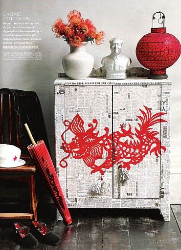 Dressers and cabinets can become pieces of creative expression. This oriental theme cabinet is so gorgeous! The newspaper base is easy, use decals to add more details. How quirky are those cord door pulls!: