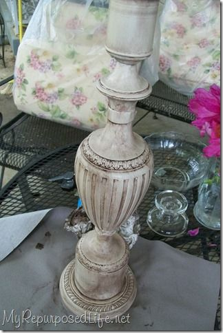 Old brass lamp repurposed as a candle holder. Cool!!