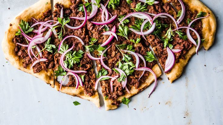 Spicy lalmb pizza with parsley-red onion salad