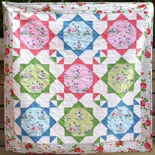 """""""Snuggle Time Baby Quilt"""" designed by Sharon Burgess for Lilabelle Lane."""
