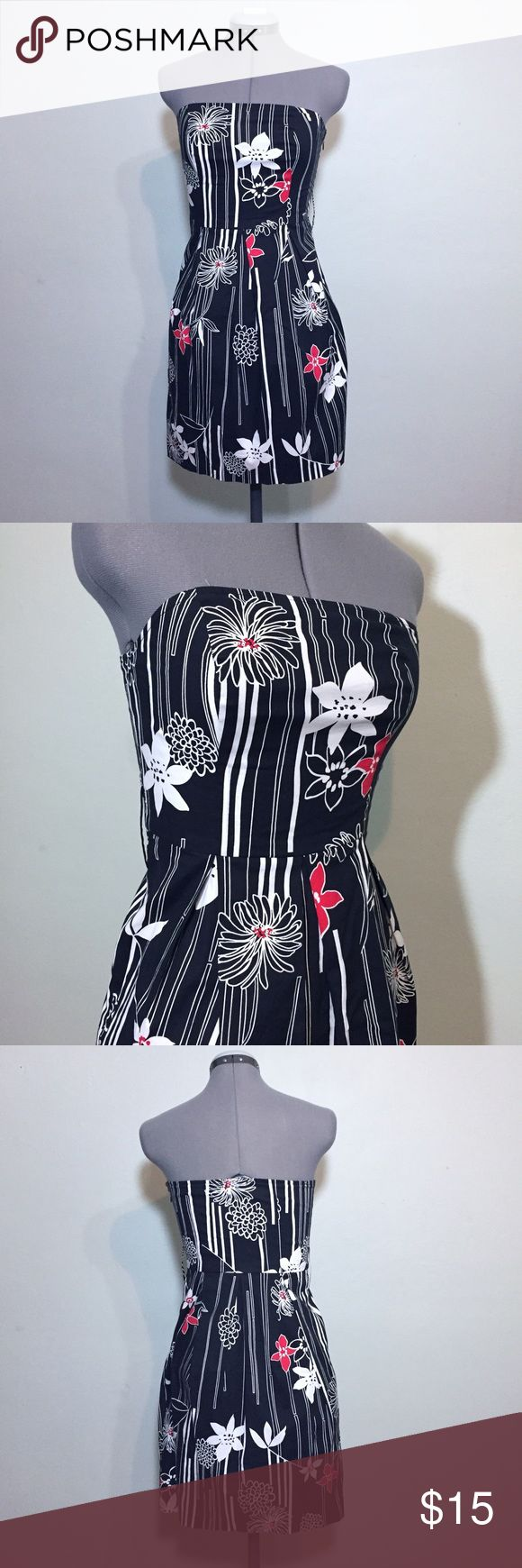 """Eyeshadow Black & White Strapless Summer Dress Adorable Eyeshadow Black & White with Splashes of Red Strapless Summer Dress. In great condition. Has belt loops for a wide belt, not included. Size Juniors 3 measures flat: 15-17"""" across chest, 13"""" across at high waist, 21"""" across hips, 28"""" long. 97% cotton, 3% spandex. Fully Limed- 100% cotton. 521/25/053117 Eyeshadow Dresses Strapless"""