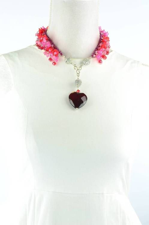 NEW DESIGN! The latest in the Attraxionz Scarlet Collection is this absolutely STUNNING necklace! A spray of gorgeous fuchsia and red glass bell cups. Attraxionz Modular Magnetic Designer Jewellery designed & handmade by Kassandra Behrendt. #attraxionz #attractions #modular #magnetic #jewellery #handmade #gifts #necklace #red #mothersday #fashion