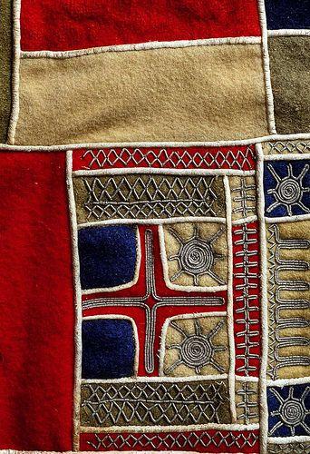"""En detalj av et samisk brystklede for kvinne kofte / kolt med tinntrådsbroderi. Lappland, Sverige. A detail of traditional Sami female clothing with pewter """"goldwork"""" embroidery from Lappland, Sweden."""