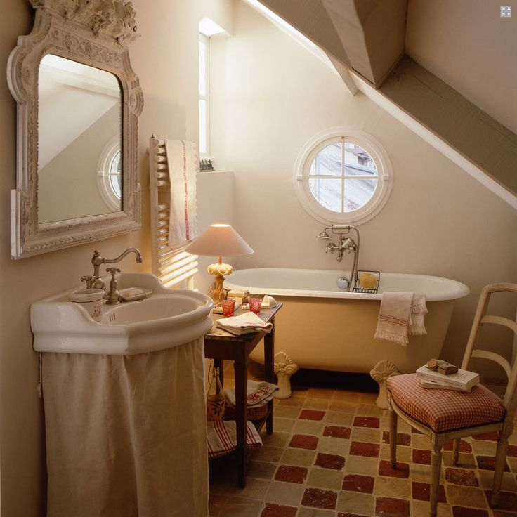 I am in love with every image in this post, especially this bathroom: the tub, skirted sink, slanted ceiling, and adorable chair!