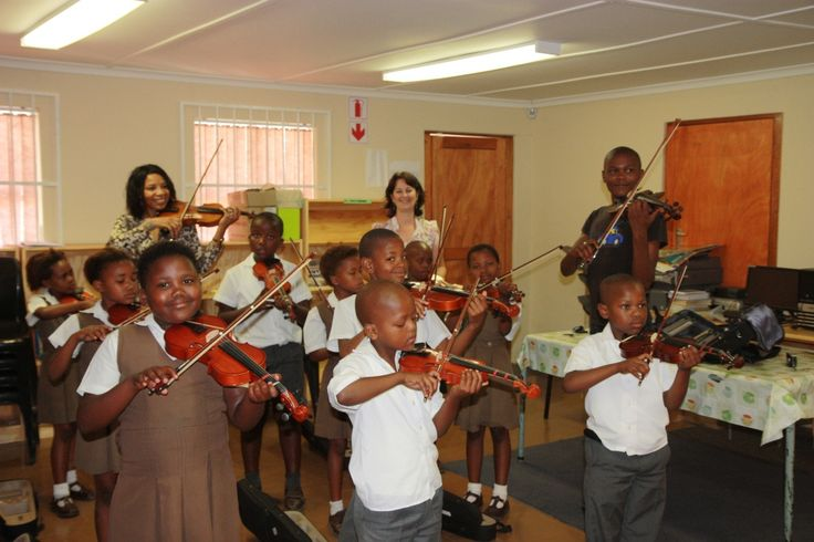 South African township kids learning classical music.
